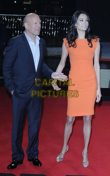 Bruce Willis & Emma Heming-Willis.attended the 'A Good Day To Die Hard' UK film premiere, Empire cinema, Leicester Square, London, England, UK, 7th February 2013..full length navy blue shirt suit hand in pocket couple wife husband orange dress .CAP/CAN.©Can Nguyen/Capital Pictures.