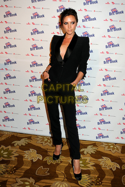 "VICTORIA BECKHAM .BritWeek 2010 Charity Event: ""Save The Children and Virgin Unite"" held at the Beverly Wilshire Hotel, Beverly Hills, California, USA, 22nd April 2010..full length tuxedo tux suit trousers shoes platform heels  no bra braless cleavage  hands in pockets shoulder pads .CAP/ADM/BP.©Byron Purvis/AdMedia/Capital Pictures."