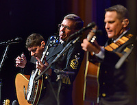 STAFF PHOTO BEN GOFF  @NWABenGoff -- 09/22/14 Keith M. Arneson plays the banjo as the U.S. Navy Band country/bluegrass ensemble Country Current performs for a packed house in the Arend Arts Center at Bentonville High School on Monday September 22, 2014. The band from Washington, D.C. is currently on a 13-city tour through the Southern states. Arneson, of Waldorf, Md., is only the second banjo player featured in the band since it's inception in 1972.