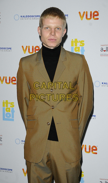 Charlie Palmer-Merkle<br /> The &quot;It's A Lot&quot; UK film premiere, Vue West End cinema, Leicester Square, London, England.<br /> October 21st, 2013<br /> half length black top beige brown suit   <br /> CAP/CAN<br /> &copy;Can Nguyen/Capital Pictures