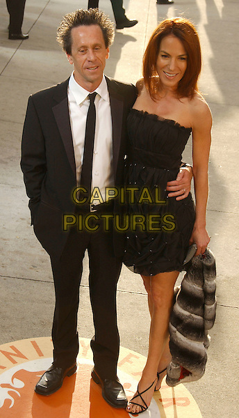 BRIAN GRAZER & GIGI LEVANGIE.The 2007 Vanity Fair Oscar Party Hosted by Graydon Carter held at Morton's, West Hollywood, California, USA,.25 February 2007..full length black dress strapless dress.CAP/ADM/GB.©Gary Boas/AdMedia/Capital Pictures.