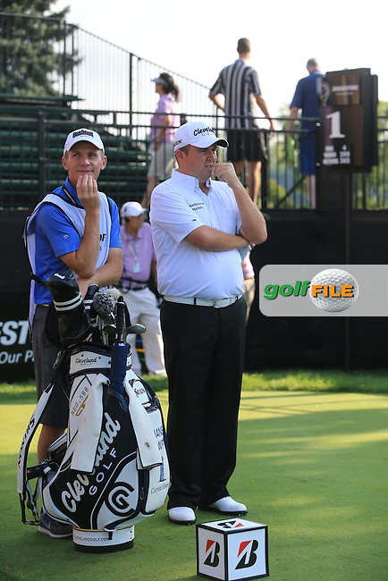 Shane Lowry (IRL) and caddy Dermot Byrne on the 1st tee to start his match during Thursday's Round 1 of the 2013 Bridgestone Invitational WGC tournament held at the Firestone Country Club, Akron, Ohio. 1st August 2013.<br /> Picture: Eoin Clarke www.golffile.ie