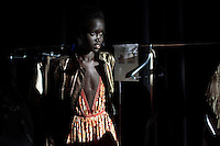 CAPE TOWN, SOUTH AFRICA - JULY 14: Sudanese model Akuol de Mabior prepare backstage before a show with the Cape Town based designer Gavin Rajah a fashion show at the the Cape Town Fashion Week on July 14, 2011, in Cape Town, South Africa. Some of South Africa's finest designers showed their 2011 Spring and summer collections during the 3 day event. (Photo by Per-Anders Pettersson)