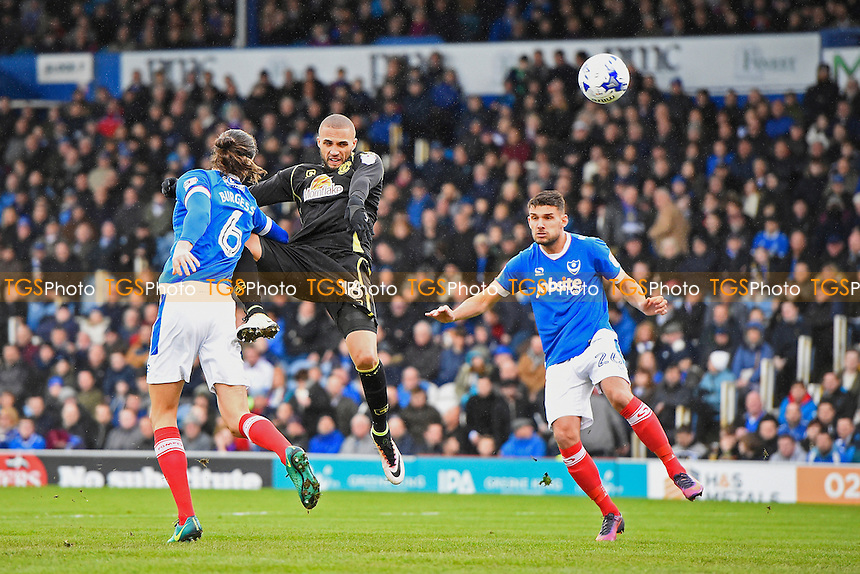 Jordan Bowery of Crewe Alexandra middle wins a header from Christian Burgess of Portsmouth during Portsmouth vs Crewe Alexandra, Sky Bet EFL League 2 Football at Fratton Park on 4th March 2017
