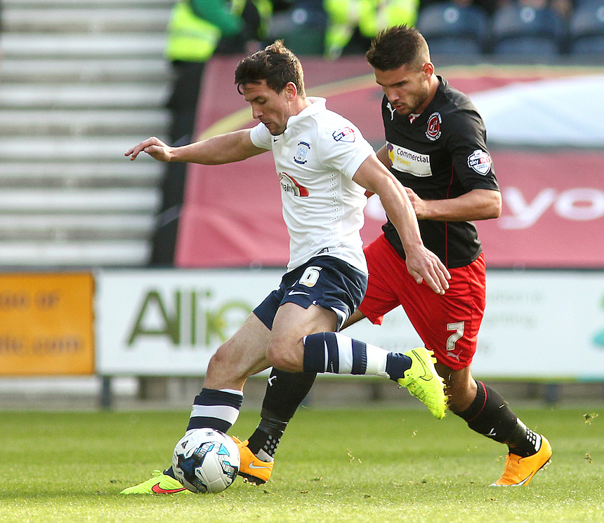 Preston North End's David Buchanan vies for possession with Fleetwood Town's Gareth Evans<br /> <br /> Photographer Rich Linley/CameraSport<br /> <br /> Football - The Football League Sky Bet League One - Preston North End v Fleetwood Town - Saturday 25th October 2014 - Deepdale - Preston<br /> <br /> &copy; CameraSport - 43 Linden Ave. Countesthorpe. Leicester. England. LE8 5PG - Tel: +44 (0) 116 277 4147 - admin@camerasport.com - www.camerasport.com