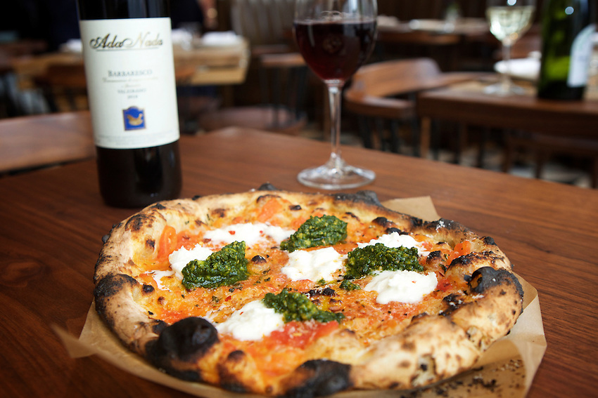 New York, NY - May 17, 2016: A personal pizza at Laurent Tourondel's L'Amico by chef Larry Baldwin in the Eventi Hotel in Midtown South.<br /> <br /> CREDIT: Clay Williams for Haute Life.<br /> <br /> &copy; Clay Williams / claywilliamsphoto.com