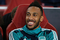 Arsenal's Pierre-Emerick Aubameyang in cheerful mood on the substitute's bench during Arsenal vs Standard Liege, UEFA Europa League Football at the Emirates Stadium on 3rd October 2019