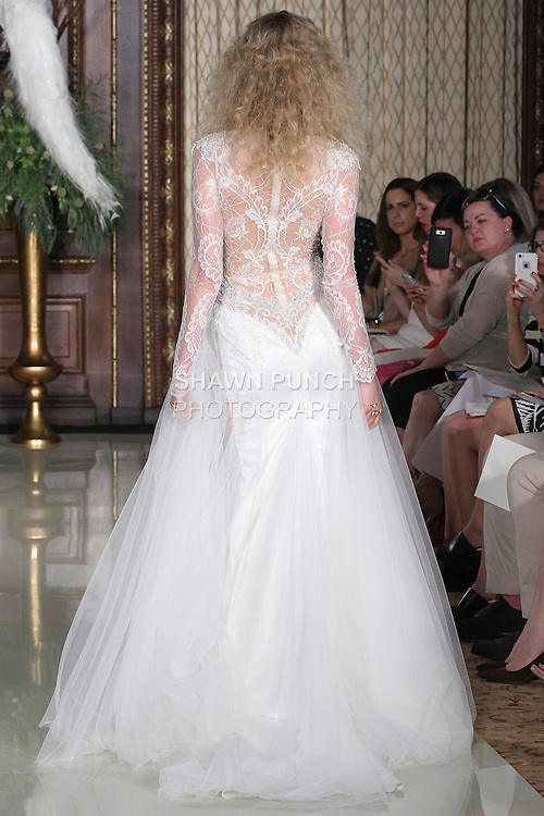 """Model walks runway in a Felicity wedding gown from the Galia Lahav Haute Couture """"Les Reves Bohemiens"""" collection, during New York Bridal Fashion Week Spring 2016."""