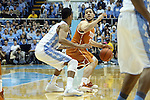 18 December 2013: Texas' Javan Felix (3) is defended by North Carolina's J.P. Tokoto (13). The University of North Carolina Tar Heels played the University of Texas Longhorns at the Dean E. Smith Center in Chapel Hill, North Carolina in a 2013-14 NCAA Division I Men's Basketball game. Texas won the game 86-83.