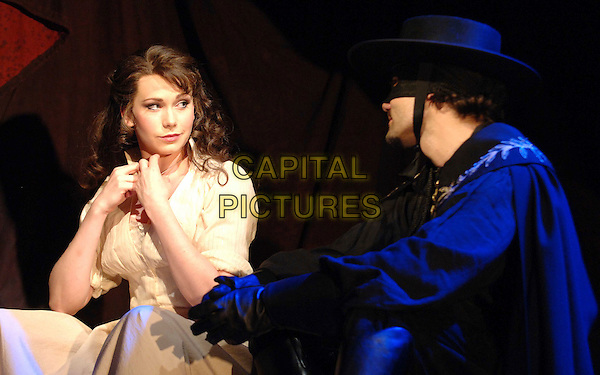 EMMA WILLIAMS & MATT RAWLE .in a scene from Zorro The Musical, based on The Mask of Zorro, Garrick Theatre, London, England, .July 9th 2007..stage photocall play costume mask black hat cape half length white cream dress.CAP/WIZ.©Wizard/Capital Pictures