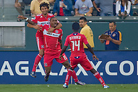 Chicago Fire forward Collins John celebrates his goal with teammates Patrick Nyarko & Baggio Husidic. The Chicago Fire beat the LA Galaxy 3-2 at Home Depot Center stadium in Carson, California on Sunday August 1, 2010.