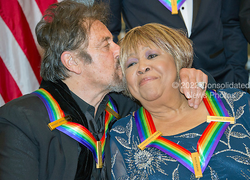 Al Pacino one of the five recipients of the 39th Annual Kennedy Center Honors kisses another recipient, gospel and blues singer Mavis Staples as they prepare to pose for a group photo following a dinner hosted by United States Secretary of State John F. Kerry in their honor at the U.S. Department of State in Washington, D.C. on Saturday, December 3, 2016.  The 2016 honorees are: Argentine pianist Martha Argerich; rock band the Eagles; screen and stage actor Al Pacino; gospel and blues singer Mavis Staples; and musician James Taylor.<br /> Credit: Ron Sachs / Pool via CNP