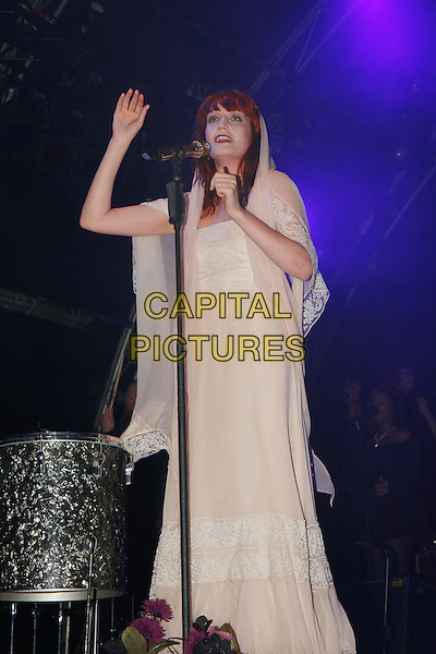 FLORENCE WELCH.Florence and The Machine perform live at Somerset House, London, England..July 15th, 2010.stage concert live gig performance music full length white dress singing hand hood sheer.CAP/MAR.© Martin Harris/Capital Pictures.