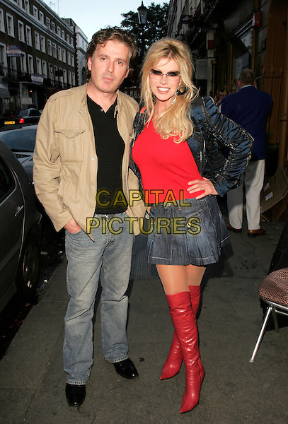 GUEST & CINDY JACKSON.Attending the Hollywood Heat Book Launch Party, Beauchamp Bar, Beauchamp Place, London, England..August 12th 2008.full length sunglasses shades red top boots denim jean skirt knee high hand on hip beige jacket.CAP/AH.©Adam Houghton/Capital Pictures.