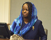 Mildred Muhammad, ex-wife, of convicted sniper John Allen Muhammad, looks over to the defense table as she begins her testimony in the penalty phase of the trial in Virginia Beach Circuit Court in Virginia Beach, Virginia on November 19, 2003.  Now in the punishment phase of the trial, the jury can only choose execution or life in prison without parole for Muhammad, who was found guilty Monday, November 17, 2003 of all charges, including two capital murder counts, in one of 10 fatal shootings that terrorized the Washington, D.C., area in 2002. <br /> Credit: Tracy Woodward - Pool via CNP