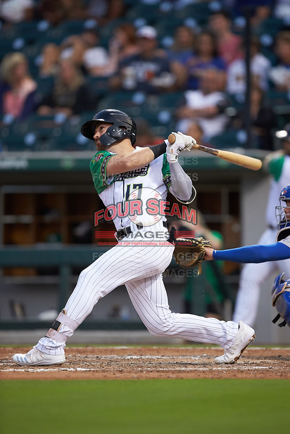 Danny Mendick (17) of the Caballeros de Charlotte follows through on his swing against the Buffalo Bisons at BB&T BallPark on July 23, 2019 in Charlotte, North Carolina. The Bisons defeated the Caballeros 8-1. (Brian Westerholt/Four Seam Images)