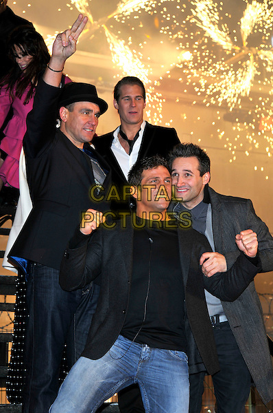VINNIE JONES, DANE BOWERS, ALEX REID.Leaving The Big Brother House, Celebrity Big Brother Final 2010, Borehamwood, Hertfordshire, UK.29th January 2010.final BB CBB winner half length black hat hand fists gesture raised up arm grey gray jacket blazer pinstripe jeans t-shirt  waistcoat steps stairs smiling mouth open .CAP/PL.©Phil Loftus/Capital Pictures.