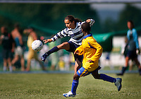 Duel between a players from FFA Mali (yellow) and Norwegian team Frigg. Norway Cup is the worlds largest football tournament, in 2008 bringing together 30.000 children from all over the world, aged 10 to 19. They make up 1386 teams playing a total of 4400 matches during the week they play. The tournament is played on a big grass field just outside the center of Oslo, Norway.