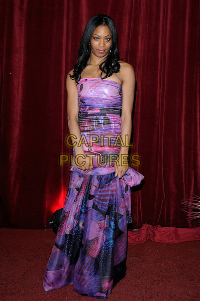 SIMONE JONES .Attending The British Soap Awards 2010, The London Television Centre, London, England, UK, 8th May 2010 .arrivals full length strapless purple dress print clutch bag pattern patterned .CAP/CAN.©Can Nguyen/Capital Pictures.