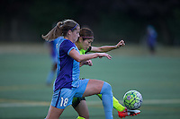 Seattle, WA - Saturday July 23, 2016: Maddy Evans, Nahomi Kawasumi during a regular season National Women's Soccer League (NWSL) match between the Seattle Reign FC and the Orlando Pride at Memorial Stadium.