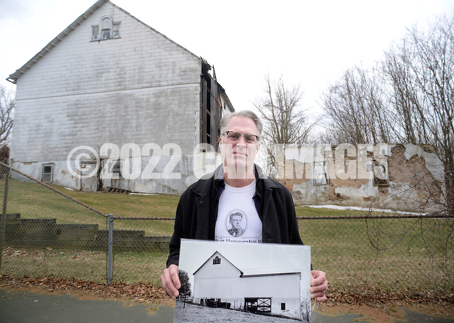 Will Hammerstein, holds a photograph of the old barn which is now in disrepair, as he discusses the project Friday March 24, 2017 at Highland Farm in Doylestown, Pennsylvania. Hammerstein is in the process of raising money to restore the old brand create a Hammerstein museum dedicated to his grandfather, Oscar Hammerstein, writer of the broadway musicals, Sound of Music, King and I, Oklahoma and Carousel to name a few. (WILLIAM THOMAS CAIN / For The Philadelphia Inquirer)
