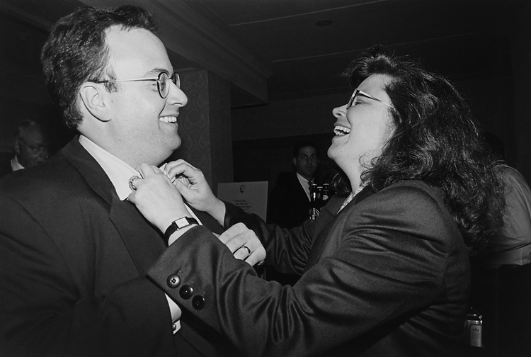 Adjusting husband Joe Waldholtz's tie at a reception is Rep. Enid Greene Mickelsen, R-Utah. (Photo by Maureen Keating/CQ Roll Call via Getty Images)