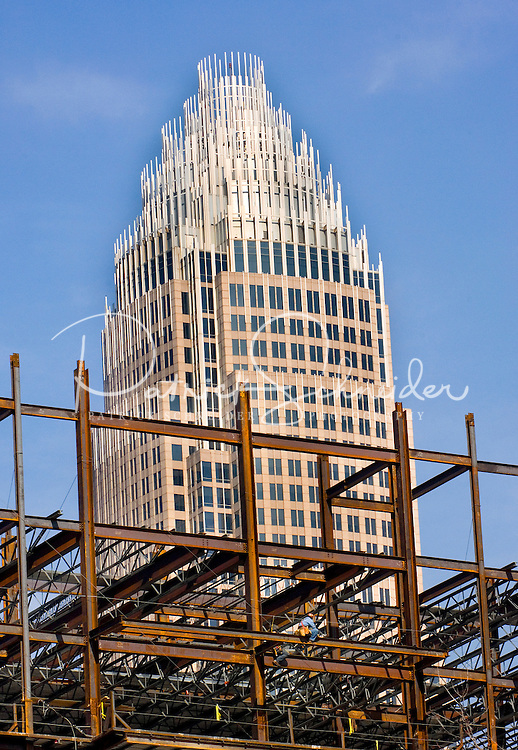 "02/26/07:  Verticalphoto of the Charlotte, NC skyline with a skyscraper under construction. Charlotte is North Carolina's largest city and the 20th-largest city in the United States. Charlotte is one of the country's fastest-growing cities, Between 1990 and 2006, Charlotte's population jumped 46 percent, to 630,478. In 2006, the Charlotte MSA had an estimated population of 1,583,016. .. In 2008, Charlotte was chosen the ""Best Place to Live in America"" by relocate-america.com in its annual ranking, based on factors including employment opportunities, crime rates, and housing affordability.....February 26, 2007. By: Patrick Schneider- Patrick Schneider Photography..."