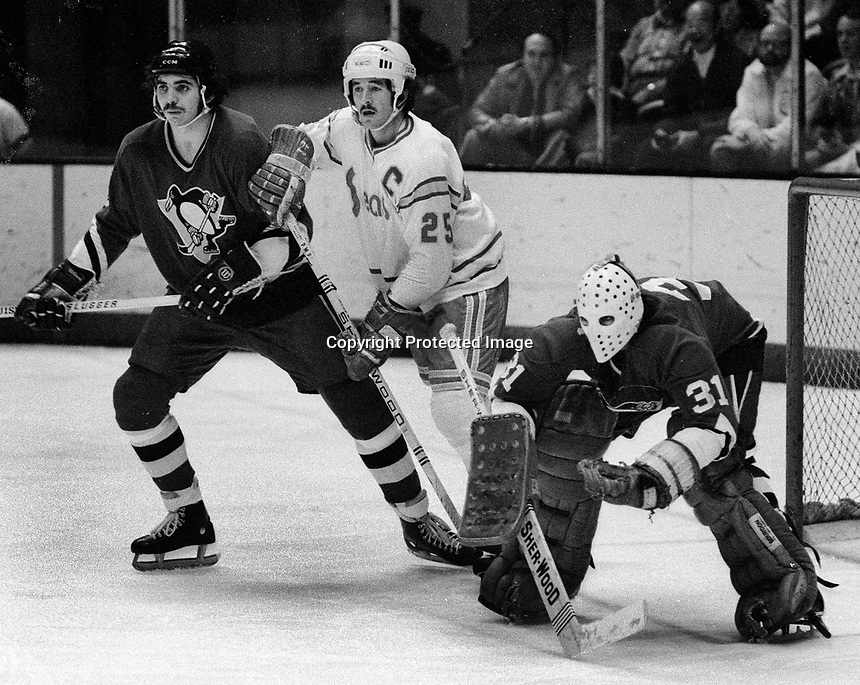 California Golden Seals Al MacAdam with Pittsburg Penguins Ron Stackhouse, and goalie Michael Plasse.<br />