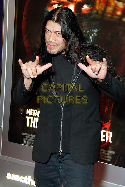 Robert Trujillo <br /> Metallica bassist Robert Trujillo at the opening night showing of the Picturehouse film, 'Metallica Through The Never' at AMC Franklin Mills, Philadelphia, Pennsylvania, USA, September 26th 2013.<br /> half length black suit jacket rock hand gesture <br /> CAP/MPC/STA<br /> &copy;Star Shooter/MediaPunch/Capital Pictures