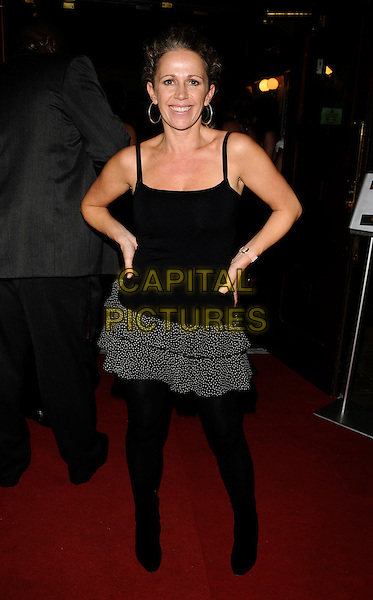 "LUCY BENJAMIN .At ""The Pretender Agenda"" Press Night, New Players Theatre,The Arches,  Villiers Street, London, England, .August 28th 2008..full length black top mini rara ra ra skirt hands on hips vest tights hoop earrings .CAP/CAN.©Can Nguyen/Capital Pictures"