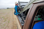 Kitty Barnett Riding With Boat & Pens In Back Of Truck
