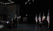 Fairfax, VA - August 3, 2009 -- United States President Barack Obama, Vice President Joseph Biden, U.S. Secretary of Veterans Affairs Eric Shinseki, Marine Corps Staff Sergeant James Miller, U.S. Senator Jim Webb (Democrat of Virginia), and former U.S. Senator John Warner (Republican of Virginia, left to right, attend an event to mark the implementation of the Post-9/11 GI Bill at George Mason University in Fairfax, Virginia on Monday, August 3, 2009. .Credit: Roger L. Wollenberg / Pool via CNP