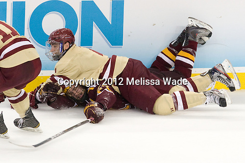 Zach Budish (Minnesota - 24), Tommy Cross (BC - 4) - The Boston College Eagles defeated the University of Minnesota Golden Gophers 6-1 in their 2012 Frozen Four semi-final on Thursday, April 5, 2012, at the Tampa Bay Times Forum in Tampa, Florida.