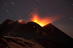 Nighttime strombolian activity, the precursor of a paroxysmal eruption of Mount Etna Volcano, Italy, 2012.