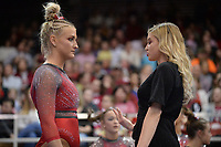 Arkansas interim assistant coach Catelyn Orel speaks Friday, Feb. 7, 2020, with Sarah Shaffer during the Razorbacks' meet with Georgia in Barnhill Arena in Fayetteville. Visit  nwaonline.com/gymbacks/ for a gallery from the meet.<br /> (NWA Democrat-Gazette/Andy Shupe)