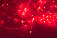 Hanging display of fibre optic cables.  They constantly change colour.  The kids can see, touch and move them.  Sensory Room where kids have individual experiences of light, sound and touch, Special Unit, state Primary School.
