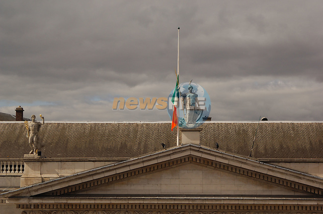 Dublin Ireland, Easter Sunday 1916 Rising Commemoration parade. 90th anniversary of the Irish Rising against British Rule in Ireland. The Irish flag (tricolour) flies at half mast in honour of those that died in the fight for independence this day 90 years ago..Photo AFP/NEWSFILE/BARRY CRONIN..(Photo credit should read AFP PHOTO BARRY CRONIN/NEWSFILE)...This Picture has been sent you under the condtions enclosed by:.Newsfile Ltd..the Studio,.Millmount Abbey,.Drogheda,.Co Meath..Ireland..Tel: +353(0)41-9871240.Fax: +353(0)41-9871260.GSM: +353(0)86-2500958.email: pictures@newsfile.ie.www.newsfile.ie.FTP: 193.120.102.198..This picture is from pictures@newsfile.ie