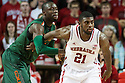 December 4, 2013: Leslee Smith (21) of the Nebraska Cornhuskers trying to get away from Tonye Jekiri (23) of the Miami (Fl) Hurricanes at the Pinnacle Bank Areana, Lincoln, NE. Nebraska defeated Miami 60 to 49.
