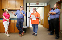 NWA Democrat-Gazette/DAVID GOTTSCHALK  Jeff Pederson (second from left), senior vice president commercial real estate with Lindsey & Associates, describes the property Monday, August 3, 2015 during a tour of the Chamber of Commerce building in Fayetteville. Aldermen will consider a resolution asking Mayor Lioneld Jordan's administration to further study buying the Chamber of Commerce building located at 123 W. Mountain Street at their 5:30 p.m. meeting today (Tuesday).