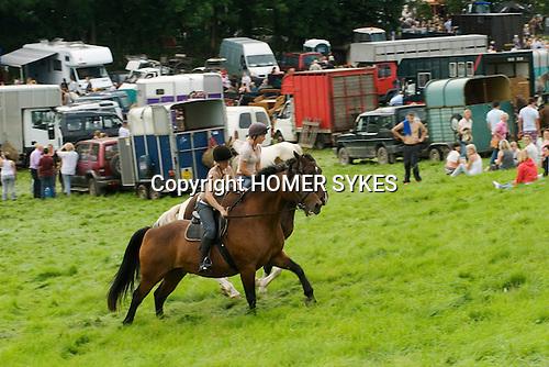 Priddy Horse Fair Somerset Uk 2009 Young girls horseback riding.