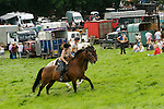 Priddy Horse Fair Somerset Uk 2009 Young girls horseback riding.