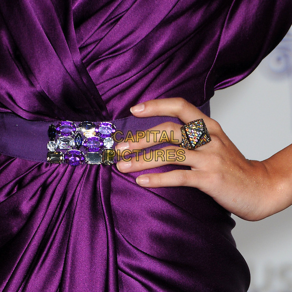 "SELENA GOMEZ's hand.""Justin Bieber: Never Say Never"" Los Angeles Premiere held at Nokia Theater L.A. Live, Los Angeles, California, USA, .8th February 2011..detail ring purple silk satin pyramid jewelled embellished .CAP/ADM/BP.©Byron Purvis/AdMedia/Capital Pictures."