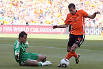14 JUN 2010:  Thomas Sorensen (DEN)(left) prepares to block the movement by Robin van Persie (NED)(9).  The Netherlands National Team defeated the Denmark National Team 2-0 at Soccer City Stadium in Johannesburg, South Africa in a 2010 FIFA World Cup Group E match.