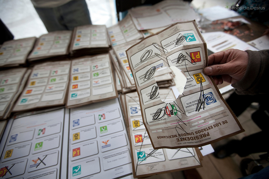 1 July 2012 - Mexico City, Mexico - An election worker holds an invalid ballot as he counts votes during the Mexico general election at a polling station in Mexico City. Mexicans vote for a new president on july 1. Photo credit: Benedicte Desrus