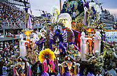 Rio de Janeiro, Brazil. Carnival; Beija flor float with its ornate costumed dancers; Sapucai at dawn.