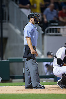 Home plate umpire Ben May during the International League game between the Norfolk Tides and the Charlotte Knights at BB&T BallPark on April 9, 2015 in Charlotte, North Carolina.  The Knights defeated the Tides 6-3.   (Brian Westerholt/Four Seam Images)