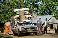MADAGASCAR Mananjary, overloaded old Peugeot car used as Taxi brousse / MADAGASKAR Mananjary , ueberladenes Peugeot Taxi