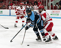 BOSTON, MA - JANUARY 04: Tereza Vanisova #21 of University of Maine attempts to control the puck as Grace Parker #20 of Boston University defends during a game between University of Maine and Boston University at Walter Brown Arena on January 04, 2020 in Boston, Massachusetts.