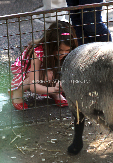 WWW.ACEPIXS.COM . . . . .  ....July 11 2012, New York City....Actress Katie Holmes took her daughter Suri Cruise to Central Park Zoo on July 11 2012 in New York City....Please byline: Zelig Shaul - ACE PICTURES.... *** ***..Ace Pictures, Inc:  ..Philip Vaughan (212) 243-8787 or (646) 769 0430..e-mail: info@acepixs.com..web: http://www.acepixs.com