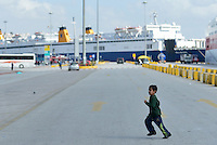 Pictured: A young boy runs about at Piraeus port, Greece Sunday 28 February 2016<br /> Re: Hundreds of migrants have arrived from the Greek islands to Piraeus Port, Greece